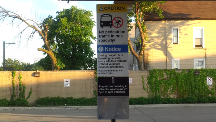 bus signs at top of escalator 6-1-16.PNG
